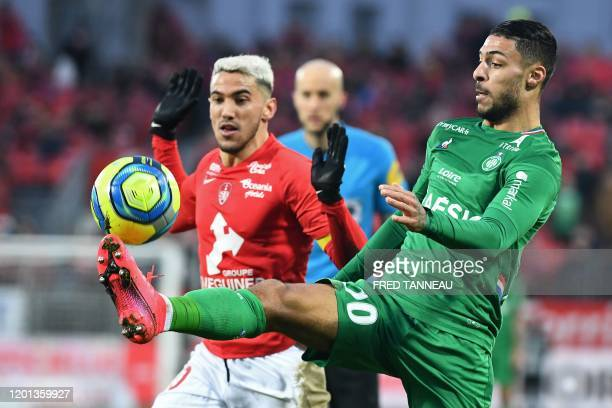 Brest's French defender Gaetan Belaud vies with SaintEtienne's Gabonese forward Denis Bouanga during the French L1 football match between Stade...