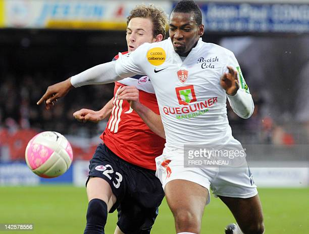 Brest's French defender Johan Martial vies with Lille's French forward Nolan Roux during the French L1 football match Brest vs Lille at the Francis...
