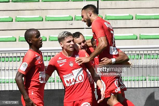 Brest's French defender Julien Faussurier is congratuled by teammates after scoring his team's first goal during the French L1 football match between...