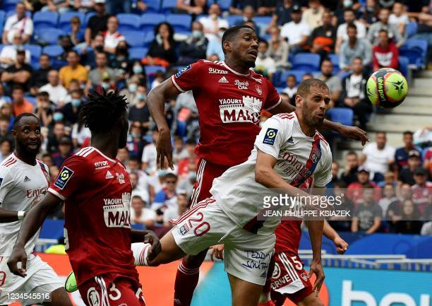 Brest's French defender Pierre-Gabriel Ronael fights for the ball with Lyon's Algerian forward Islam Slimani during the French L1 football match...