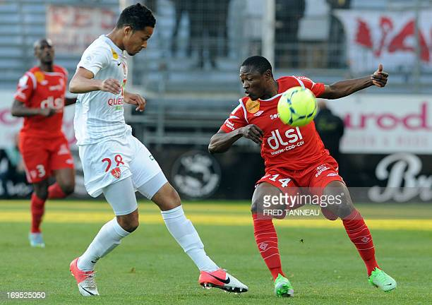 Brest's French defender Thimothée Dieng vies for the ball with Nancy's Cameroonian forward Paul Alo'o Efoulou during the French L1 football match...