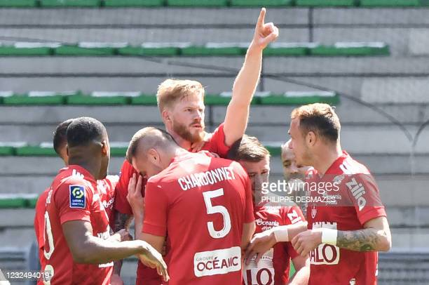 Brest's French forward Gaetan Charbonnier is congratuled by teammates after scoring a goal during the French L1 football match between AS...