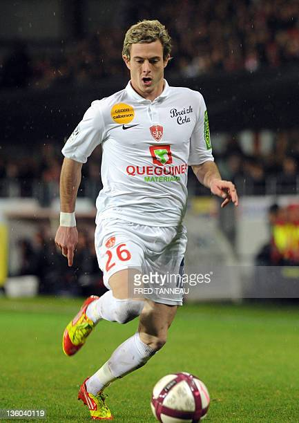 Brest's French forward Nolan Roux runs with the ball during the French L1 football match Brest vs Auxerre on December 17 2011 in Brest western France...