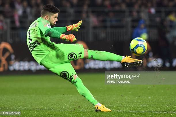 Brest's French goalkeeper Gautier Larsonneur clears the ball during the French L1 football match between Stade Brestois 29 and Amiens SC at the...