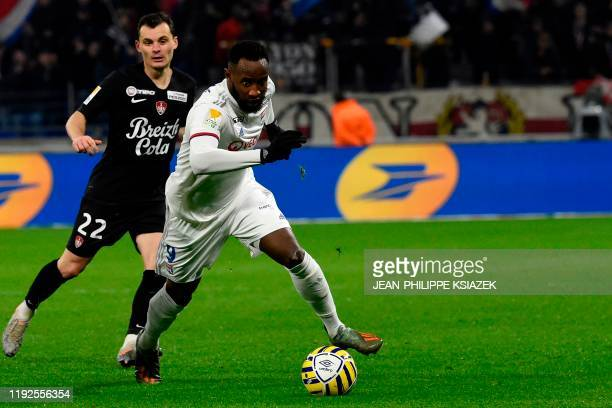 Brest's French midfielder Hugo Magnetti vies with Lyon's French forward Moussa Dembele during the French League Cup quarterfinal football match...