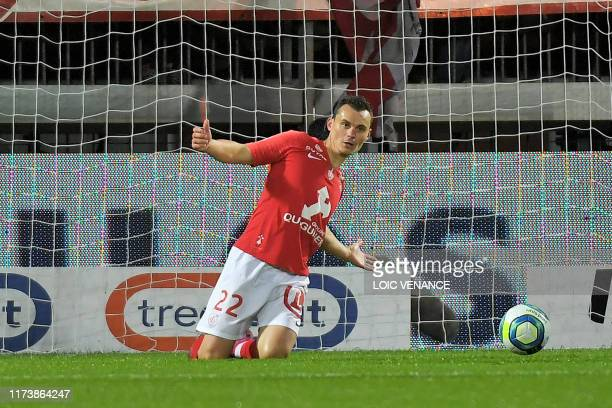 Brest's French midfielder Julien Faussurier celebrates after scoring during the French L1 football match between Stade Brestois 29 and Football Club...