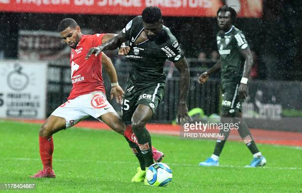 Brest's French midfielder Samuel Grandsir fights for the ball with Dijon's Gabonese defender Bruno Ecuele Manga during the French L1 football match...