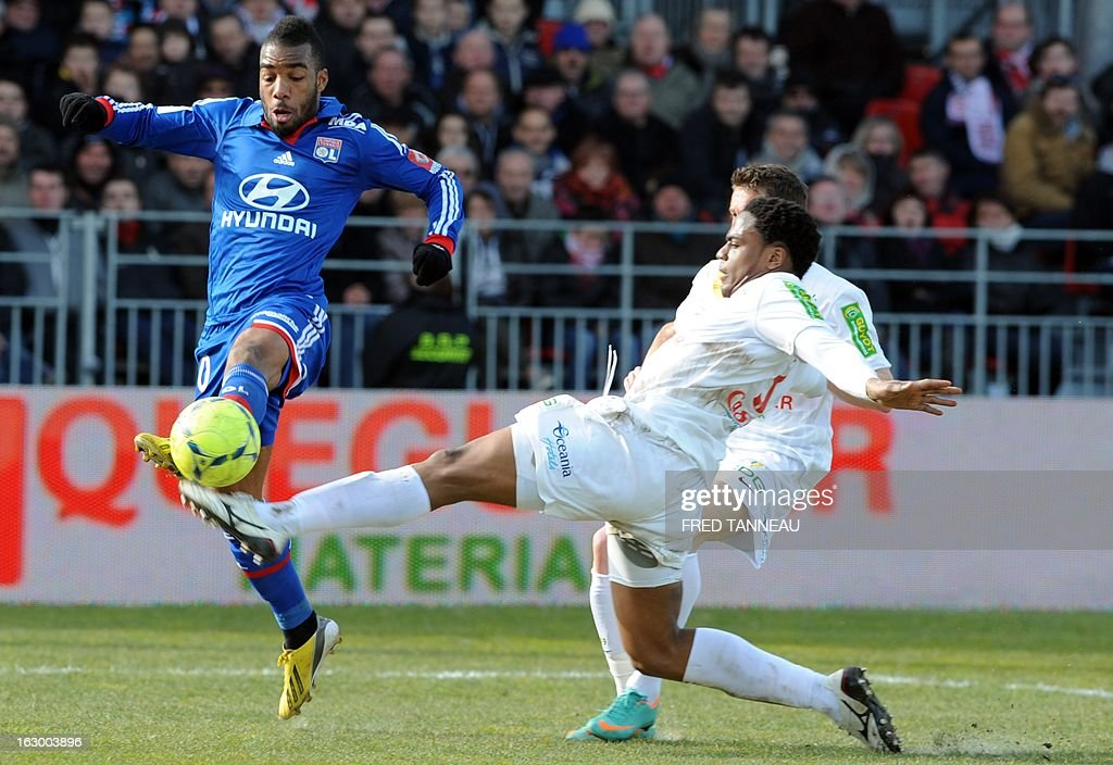 Brest's French midfielder Tripy Makonda (R) and Brest's French midfielder Benoit Lesoimier vie with Lyon's Argentinian forward Lisandro Lopez (L) during the French L1 football match Brest vs Lyon at the Francis Le Ble stadium on March 3, 2013 in Brest, western of France.