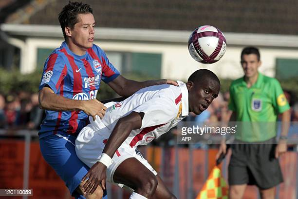 Brest's French striker Jonathan Ayite fights for the ball with Caen's French midfielder Benjamin Nivet during the friendly football match Caen vs...
