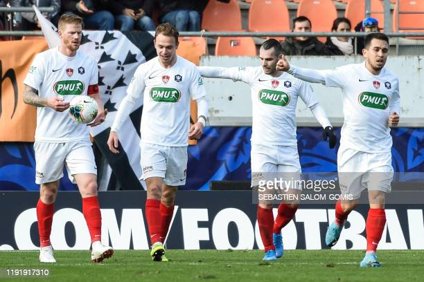 Brest's players celebrate a goal during the French Cup football match between Lorient and Brest on January 5 at the Moustoir stadium in Lorient,...
