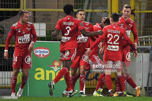 Brest's players celebrate after scoring during the French L1 football match between Racing Club Strasbourg Alsace and Stade Brestois 29 at the Meinau...