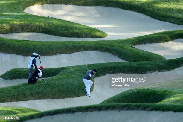 Bret Baier plays his shot from the bunker on the 11th hole during Round Three of the ATT Pebble Beach ProAm at Spyglass Hill Golf Course on February...