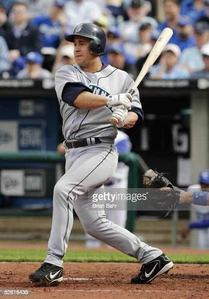 Bret Boone of the Seattle Mariners hits an RBI single in the fourth inning against the Kansas City Royals April 11 2005 at Kauffman Stadium in Kansas...