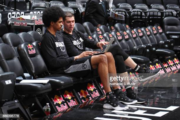Bret Brielmaier watches films with Jarrett Allen of the Brooklyn Nets before the game against the Atlanta Hawks on December 2 2017 at Barclays Center...