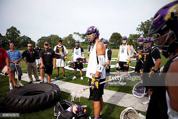 Bret Bucktooth of the Iroquois Nationals lacrosse team talks to his teammates during a practice session at the Wagner College in Staten Island as...