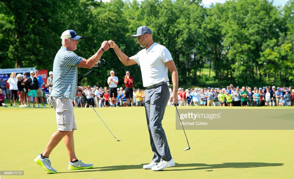 Bret Favre (L) and Derek Jeter celebrate as they finish the Celebrity Foursome to benefit the American Family Children's Hospital during the second round of the American Family Insurance Championship held at University Ridge Golf Course on June 24, 2017 in Madison, Wisconsin.
