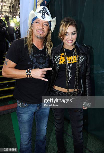 Bret Michaels and Miley Cyrus backstage before her performance on ABC's Good Morning America at Rumsey Playfield Central Park on June 18 2010 in New...