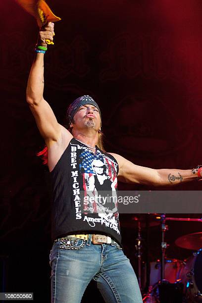 Bret Michaels enters the stage waving The Terrible Towel during his performance at the Steelers Playoff Party at Stage AE on January 14 2011 in...
