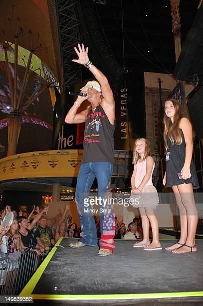 Bret Michaels Jorja Bleu Sychak and Raine Elizabeth Sychak on stage at Fremont Street on August 4 2012 in Las Vegas Nevada