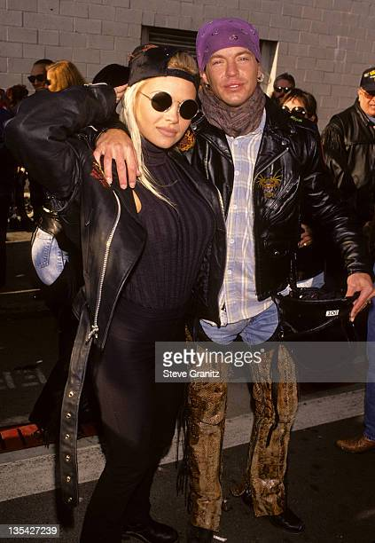 Bret Michaels of Poison and Pamela Anderson pose for a photo at Love Ride 11 to benefit muscular dystrophy on November 13 1994 in Glendale California