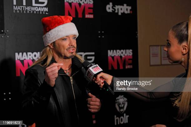 Bret Michaels of Poison is interviewed by event emcee Alyse Zwick during Marquis NYE 2020 at The New York Marriott Marquis on December 31 2019 in New...