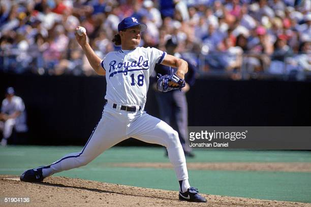 Bret Saberhagen of the Kansas City Royals winds up for a pitch during a game in 1990 at Royals Stadium in Kansas City Missouri