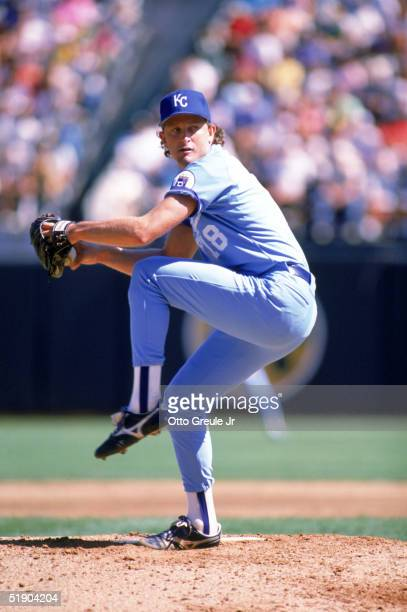 Bret Saberhagen of the Kansas City Royals winds up for a pitch during a game against the Oakland Athletics at Oakland-Alameda County Coliseum in 1989...