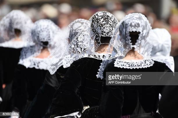 Breton dancers in traditional outfits take part on August 6 2017 in Lorient western France in the traditional street parade of the 47th Lorient...