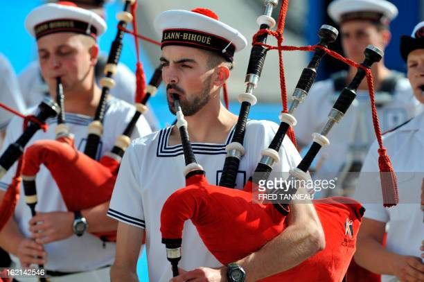 Breton traditional music band 'Bagad de Lann Bihoue' perform a traditionnal Breton dance on August 7 2011 in Lorient during the celtics nations Great...
