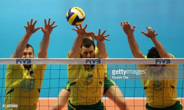 Brett Alderman, Luke Campbell and Benjamin Hardy of Australia jump to block the ball against South Korea during the FIVB Men's World Olympic...