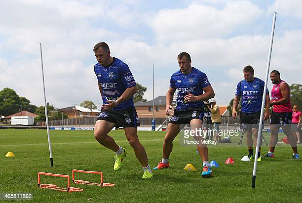 Brett and Josh Morris warm up during a Canterbury Bulldogs NRL training session at Belmore Sports Ground on March 11 2015 in Sydney Australia