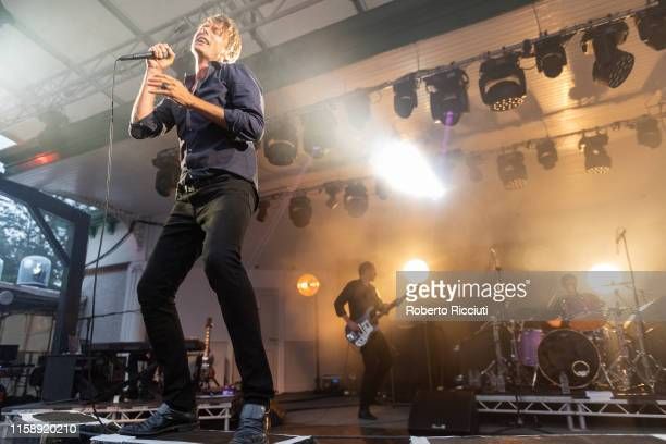Brett Anderson Mat Osman and Simon Gilbert of Suede perform on stage at Kelvingrove Park on July 31 2019 in Glasgow Scotland