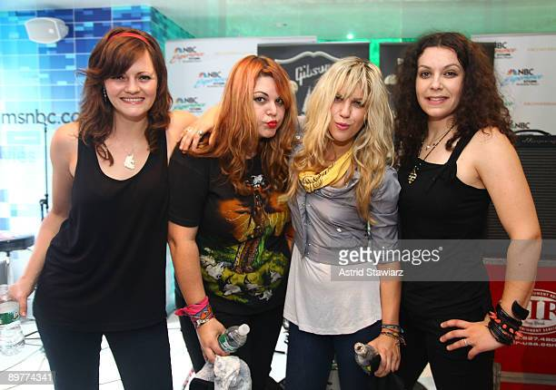 Brett Anderson Maya Ford Allison Robertson and Amy Cesari of The Donnas pay tribute to Les Paul at the NBC Experience Store as part of the Gibson...