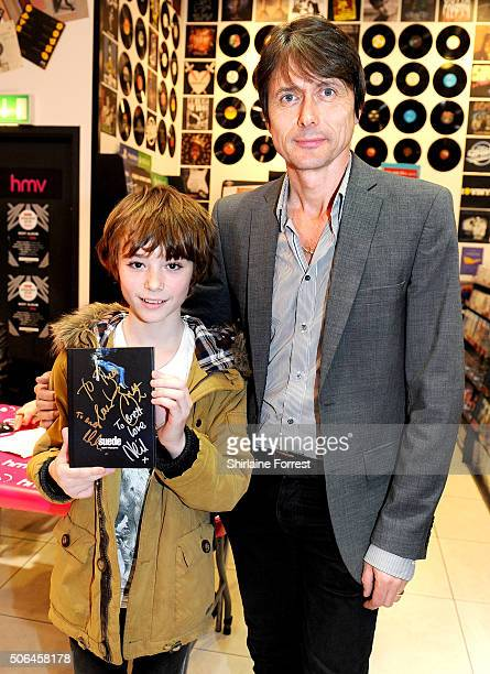 Brett Anderson of Suede performs a live acoustic set and signs copies of their new album 'Night Thoughts' at HMV Manchester on January 23 2016 in...
