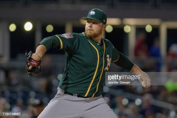 Brett Anderson of the Oakland Athletics delivers a pitch during the spring training game against the Seattle Mariners at Peoria Stadium on March 06...