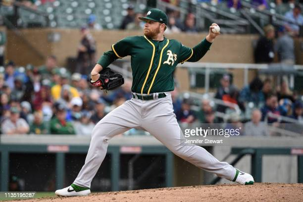 Brett Anderson of the Oakland Athletics delivers a pitch during the spring training game against the Colorado Rockies at Salt River Fields at Talking...