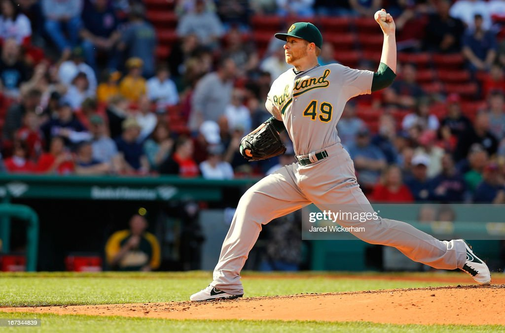 Brett Anderson #49 of the Oakland Athletics pitches against the Boston Red Sox during the game on April 24, 2013 at Fenway Park in Boston, Massachusetts.
