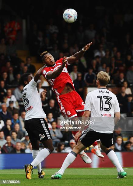 Brett Assombalonga of Middlesbrough rises above Ryan Sessegnon and Tim Ream of Fulham during the Sky Bet Championship match between Fulham and...