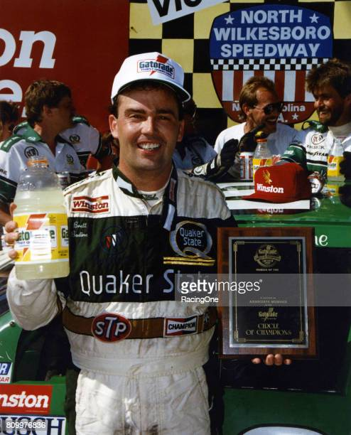 Brett Bodine driver of the Quaker State Buick celebrates joining the Gatorade Circle of Champions after winning the NASCAR Winston Cup Series First...