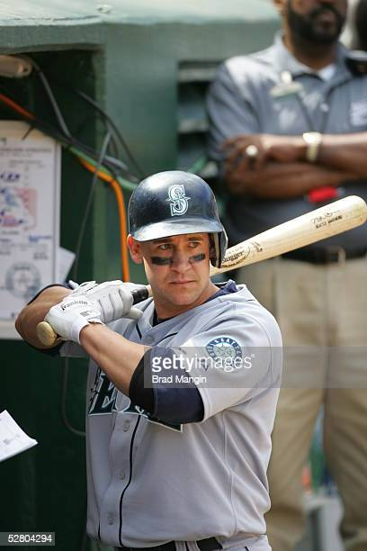Brett Boone of the Seattle Mariners is pictured in the dugout during the game against the Oakland Athletics at McAfee Coliseum on May 1, 2005 in...