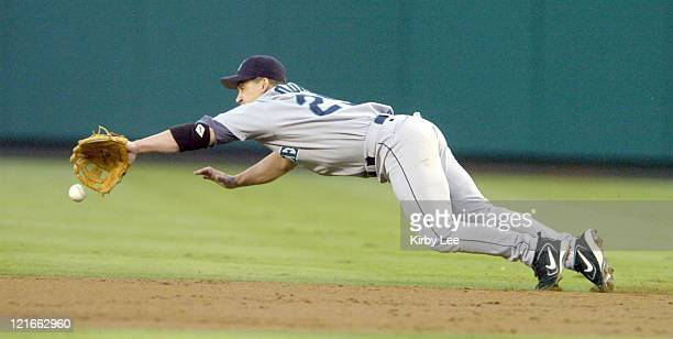 Brett Boone of the Seattle Mariners makes a diving attempt for a ground ball by Jose Guillen of the Anaheim Angels during the second inning of a 65...