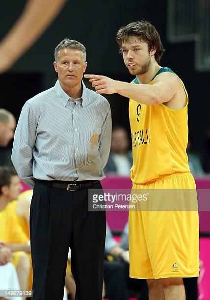 Brett Brown , head coach for Australia, talks with Matt Dellavedova of Australia in the first half of the game against China during the Men's...