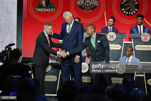 Brett Brown of the Philadelphia 76ers Mitch Kupchak of the Los Angeles Lakers and Isaiah Thomas of the Boston Celtics pose for a photo on stage...