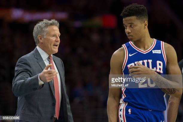 Brett Brown of the Philadelphia 76ers talks to Markelle Fultz in the third quarter against the Denver Nuggets at the Wells Fargo Center on March 26...