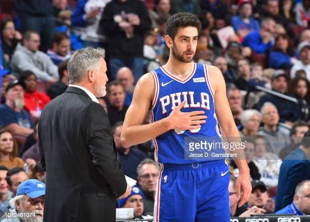 Brett Brown talks with Furkan Korkmaz of the Philadelphia 76ers during the game against the Brooklyn Nets on December 12 2018 at the Wells Fargo...