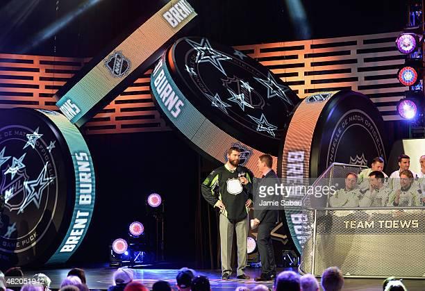 Brett Burns of the San Jose Sharks speaks to host Daren Millard after being selected by Team Foligno during the NHL AllStar Fantasy Draft as part of...