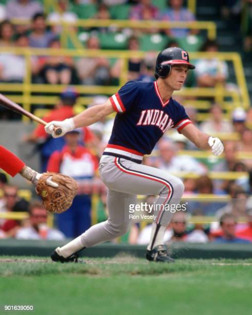 Brett Butler of the Cleveland Indians runs bats during an MLB game versus the Chicago White Sox at Comiskey Park in Chicago Illinois during the 1986...