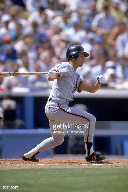 Brett Butler of the San Francisco Giants follows through on his swing during a game against the Los Angeles Dodgers in 1988 at Dodger Stadium in Los...