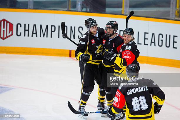 Brett Carson , John McFarland, Brock Trotter and Tero Koskiranta of Lappeenranta celebrates goal during the Champions Hockey League Round of 32 match...
