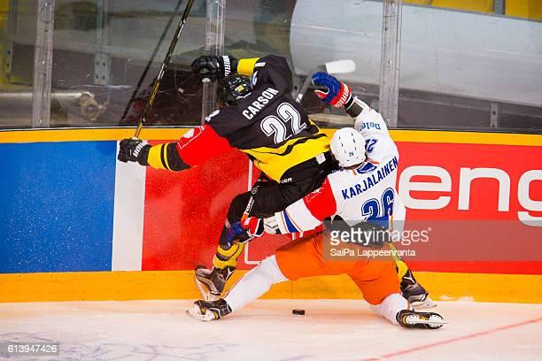 Brett Carson of Lappeenranta challenges Jere Karjalainen of Tampere during the Champions Hockey League Round of 32 match between SaiPa Lappeenranta...